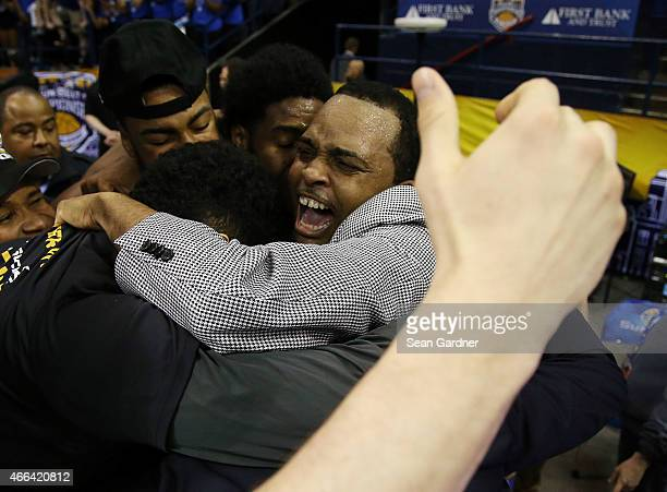 Head coach Ron Hunter of the Georgia State Panthers celebrates with his team after defeating the Georgia Southern Eagles during the Sun Belt...