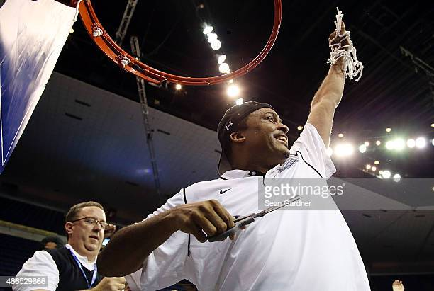 Head coach Ron Hunter of the Georgia State Panthers cuts the net on the goal after his team defeated the Georgia Southern Eaglesduring the Sun Belt...