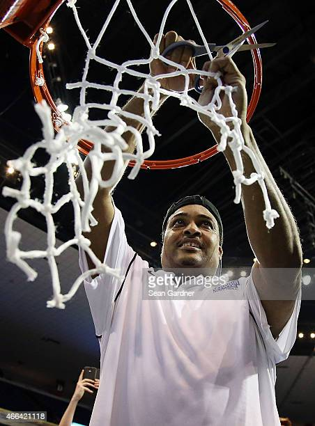 Head coach Ron Hunter of the Georgia State Panthers cuts the net after defeating the Georgia Southern Eagles during the Sun Belt Conference Men's...