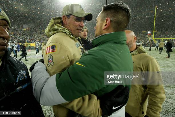 Head coach Ron Rivera of the Carolina Panthers and head coach Matt LaFleur of the Green Bay Packers shake hands after their game at Lambeau Field on...