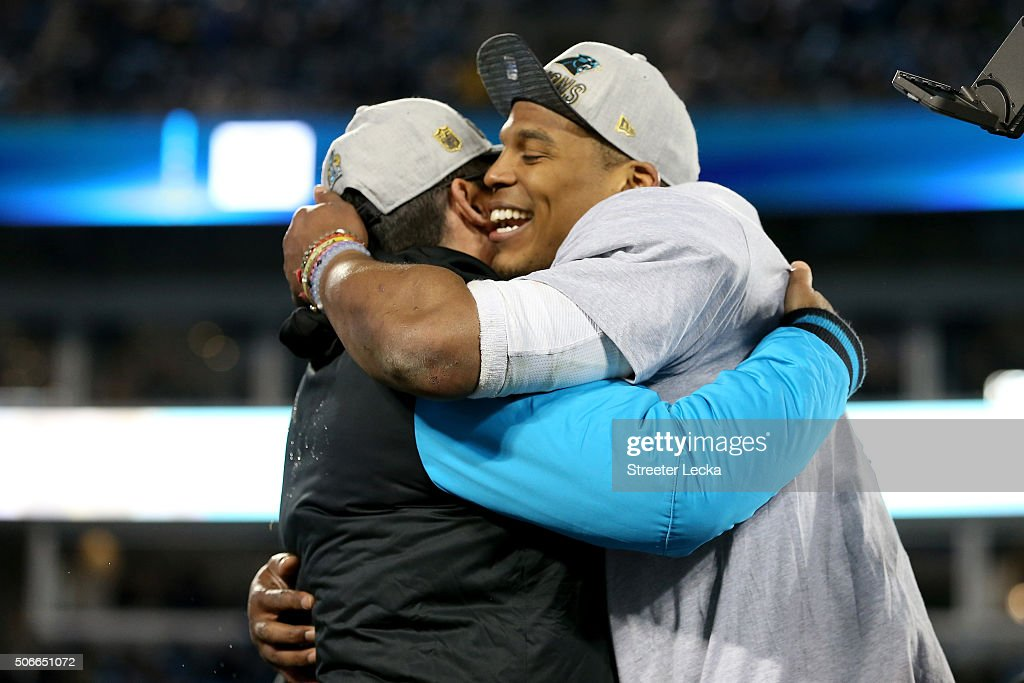 Head coach Ron Rivera of the Carolina Panthers celebrates with Cam Newton #1 after defeating the Arizona Cardinals with a score of 49 to 15 to win the NFC Championship Game at Bank of America Stadium on January 24, 2016 in Charlotte, North Carolina.