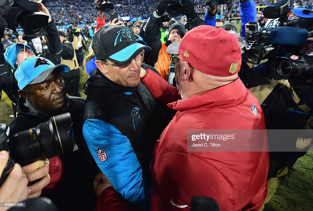 Head coach Ron Rivera of the Carolina Panthers shakes hands with head coach Bruce Arians of the Arizona Cardinals after the Carolina Panthers defeated the Arizona Cardinals with a score of 49 to 15 in the NFC Championship Game at Bank of America Stadium on January 24, 2016 in Charlotte, North Carolina.