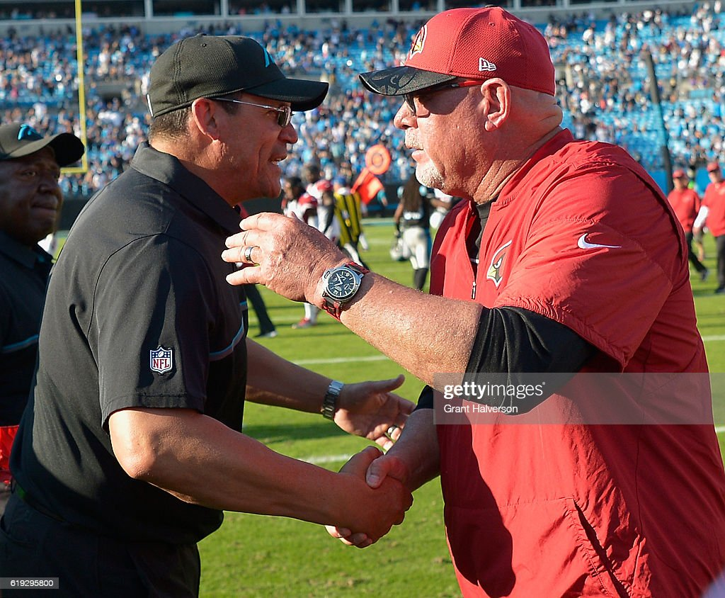 Head coach Ron Rivera of the Carolina Panthers shakes hands with head coach Bruce Arians of the Arizona Cardinals after their game at Bank of America Stadium on October 30, 2016 in Charlotte, North Carolina.