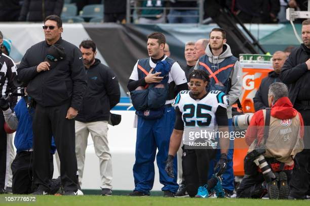 Head coach Ron Rivera of the Carolina Panthers stands for the national anthem while Eric Reid takes a knee prior to the game against the Philadelphia...