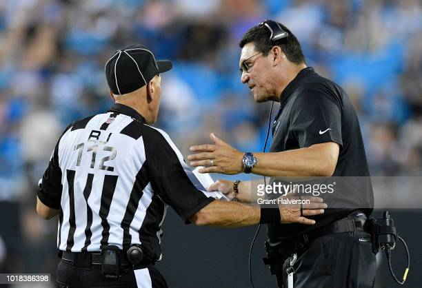 Head coach Ron Rivera of the Carolina Panthers talks to a referee in the second quarter against the Miami Dolphins during the game at Bank of America...