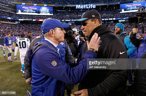 Head coach Ron Rivera of the Carolina Panthers talks with head coach Tom Coughlin of the New York Giants after their game at MetLife Stadium on...