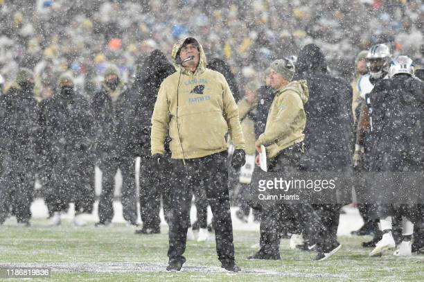 Head coach Ron Rivera of the Carolina Panthers watches the video replay during the fourth quarter against the Green Bay Packers at Lambeau Field on...