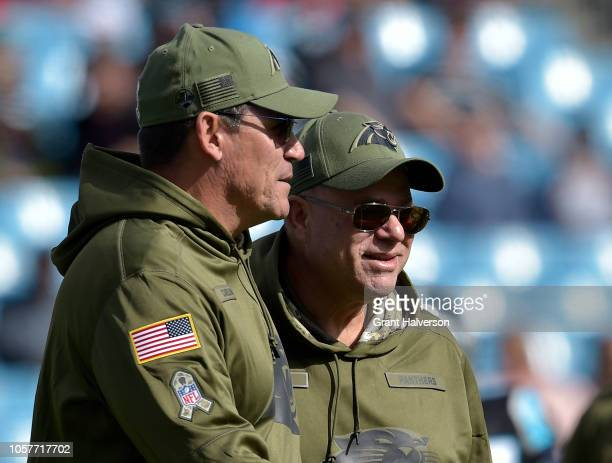 Head coach Ron Rivera talks with owner David Tepper of the Carolina Panthers during their game against the Tampa Bay Buccaneers at Bank of America...
