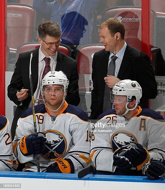 Head coach Ron Rolston and Assistant coach Kevyn Adams of the Buffalo Sabres talk during third period action against the Florida Panthers at the BBT...