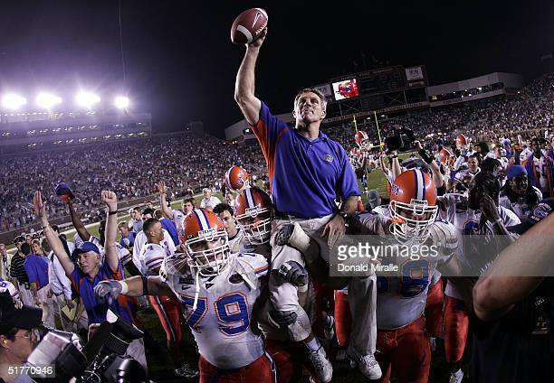 Head Coach Ron Zook of the University of Florida Gators gets carried off the field after his team's 2013 win over the Florida State Seminoles at Doak...
