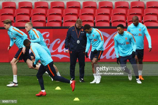 Head coach Ronald Koeman speaks Memphis Depay during the Netherlands Training session held at Amsterdam Arena also known as the Johan Cruyff Arena on...