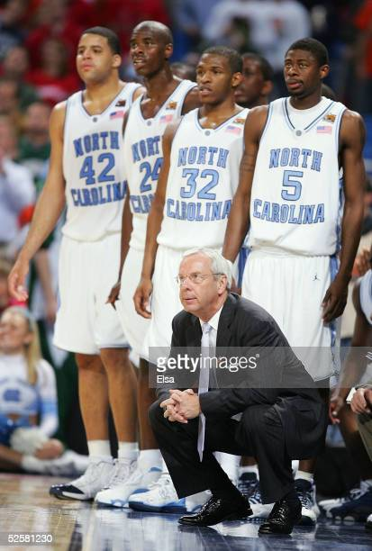 Head coach Roy Williams and several of the North Carolina Tar Heels watch from the bench area against the Michigan State Spartans during the NCAA...