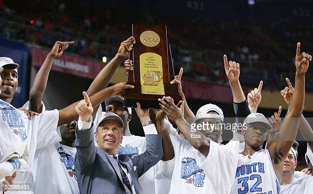 Head coach Roy Williams and the North Carolina Tar Heels celebrate with the trophy after defeating the Illinois Fighting Illini 75-70 to win the NCAA...