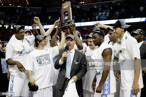 Head coach Roy Williams and the North Carolina Tar Heels celebrate after defeating the Oklahoma Sooners during the NCAA Men's Basketball Tournament...