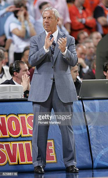 Head coach Roy Williams applauds has his team the North Carolina Tar Heels are announced before the start of the NCAA Men's Final Four against the...