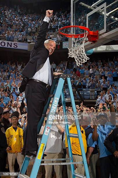 Head coach Roy Williams cuts down the nets after beating the Duke Blue Devils for the regular season ACC championship on March 05, 2011 at the Dean...