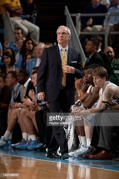 Head coach Roy Williams of the North Carolina Tar Heels adjusts his tie during a game against the Clemson Tigers on February 18 2012 at the Dean E...