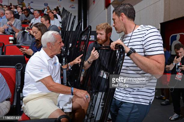 Head Coach Roy Williams of the North Carolina Tar Heels Agent Sam Goldfeder and Retired NBA Player Nick Collison are seen at the game between the...