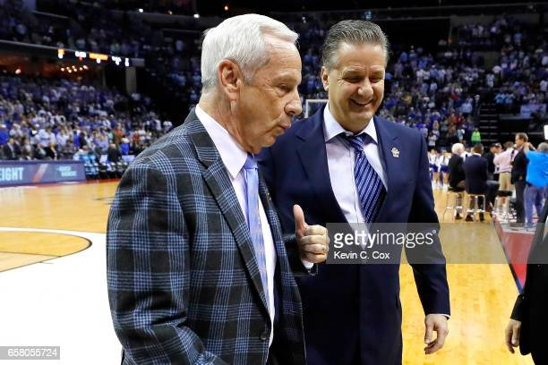 Head coach Roy Williams of the North Carolina Tar Heels and head coach John Calipari of the Kentucky Wildcats walk off the court before their game...