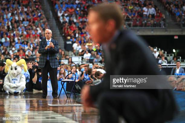 Head coach Roy Williams of the North Carolina Tar Heels and head coach Mark Few of the Gonzaga Bulldogs look on in the first half during the 2017...