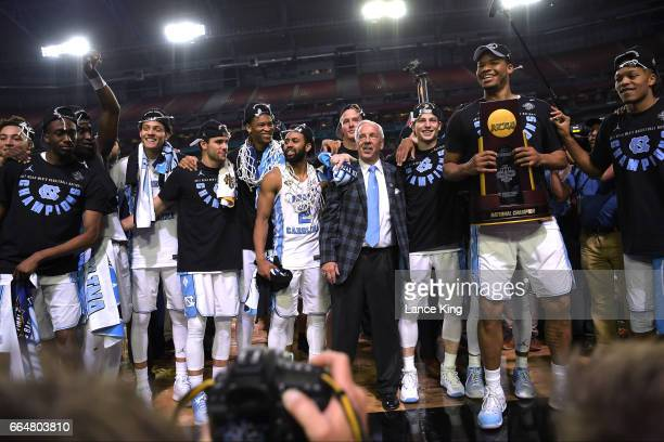 Head coach Roy Williams of the North Carolina Tar Heels and his team celebrate following their 7165 victory against the Gonzaga Bulldogs during the...