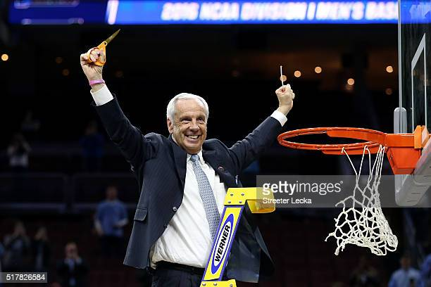 Head coach Roy Williams of the North Carolina Tar Heels celebrates by cutting down the net after defeating the Notre Dame Fighting Irish with a score...