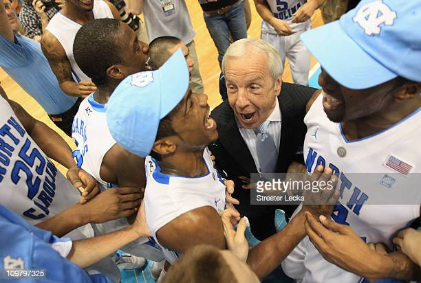 Head coach Roy Williams of the North Carolina Tar Heels celebrates winning the ACC Regular Season Championship with his players as they defeated the...