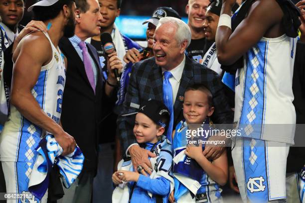 Head coach Roy Williams of the North Carolina Tar Heels celebrates with his team and grandchildren after defeating the Gonzaga Bulldogs during the...