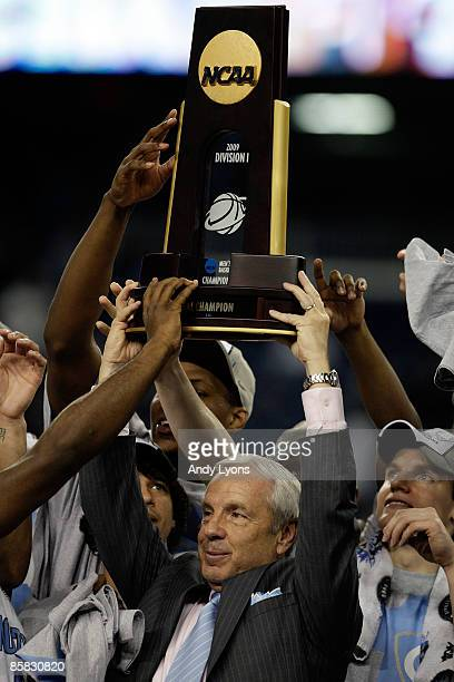 Head coach Roy Williams of the North Carolina Tar Heels celebrates with the championship trophy after defeating the Michigan State Spartans 8972...