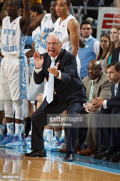 Head coach Roy Williams of the North Carolina Tar Heels cheers while playing the Iowa Hawkeyes at the Dean E. Smith Center on December 03, 2014 in...
