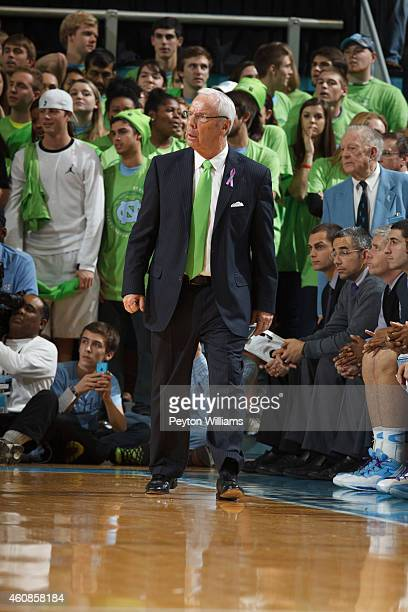 Head coach Roy Williams of the North Carolina Tar Heels coaches against the Iowa Hawkeyes at the Dean E Smith Center on December 03 2014 in Chapel...