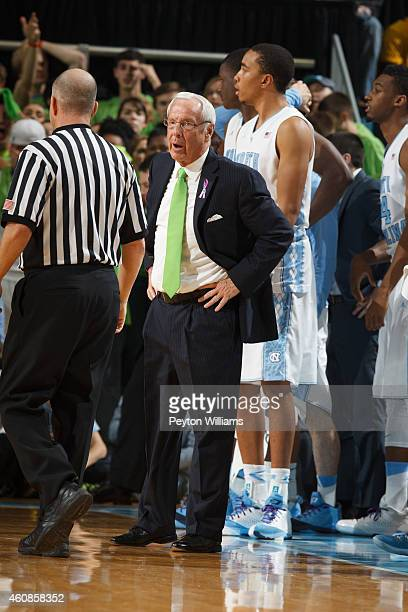 Head coach Roy Williams of the North Carolina Tar Heels coaches against the Iowa Hawkeyes at the Dean E. Smith Center on December 03, 2014 in Chapel...