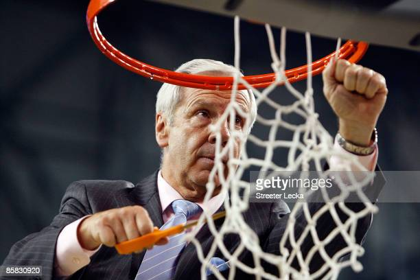 Head coach Roy Williams of the North Carolina Tar Heels cuts down a piece of the net after they 8972 win against the Michigan State Spartans during...