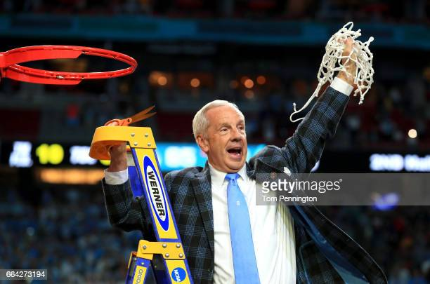 Head coach Roy Williams of the North Carolina Tar Heels cuts down the net after defeating the Gonzaga Bulldogs during the 2017 NCAA Men's Final Four...