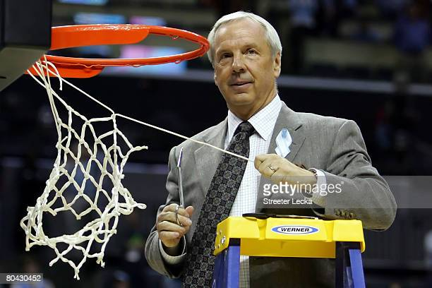 Head coach Roy Williams of the North Carolina Tar Heels cuts down the net after defeating the Louisville Cardinals during the 2008 NCAA Men's East...