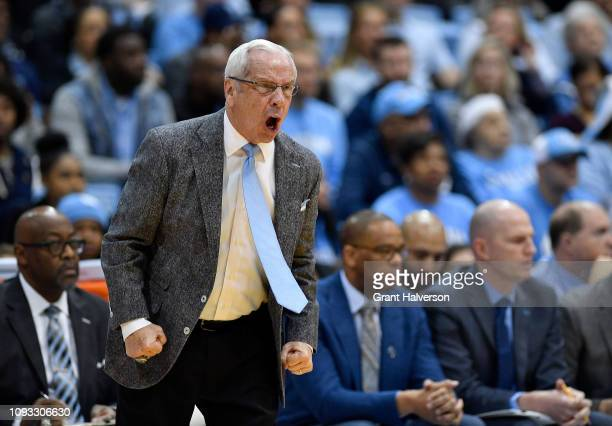 Head coach Roy Williams of the North Carolina Tar Heels directs his team against the Louisville Cardinals during the second half of their game at the...