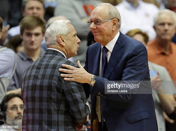 Head coach Roy Williams of the North Carolina Tar Heels is congratulated by head coach Jim Boeheim of the Syracuse Orange after winning 8568 at the...