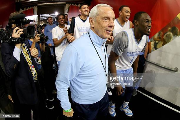 Head coach Roy Williams of the North Carolina Tar Heels takes the court with his team during a practice session for the 2016 NCAA Men's Final Four at...