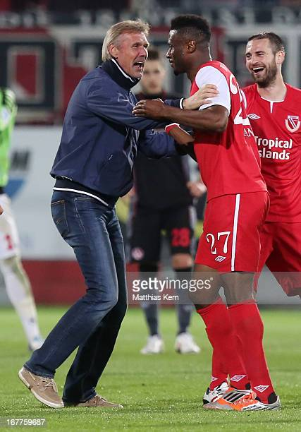 Head coach Rudolf Bommer of Cottbus and Boubacar Sanogo show their delight after winning the Second Bundesliga match between FC Energie Cottbus and...