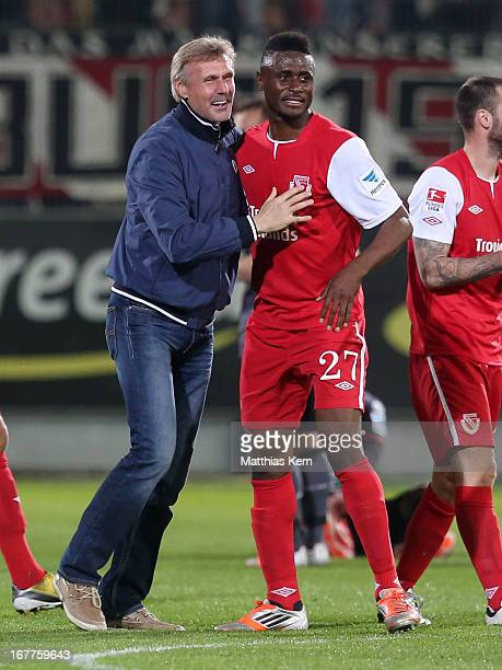 Head coach Rudolf Bommer of Cottbus Boubacar Sanogo show their delight after winning the Second Bundesliga match between FC Energie Cottbus and 1.FC...