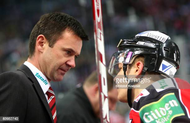 Head coach Rupert Meister of the Koelner Haie talks to Moritz Mueller during the DEL match between Koelner Haie and Iserlohn Roosters at the Lanxess...
