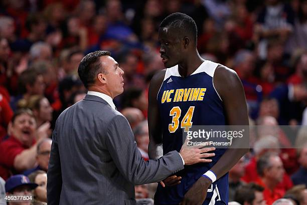 Head coach Russell Turner of the UC Irvine Anteaters talks with Mamadou Ndiaye during the second half of the college basketball game against the...