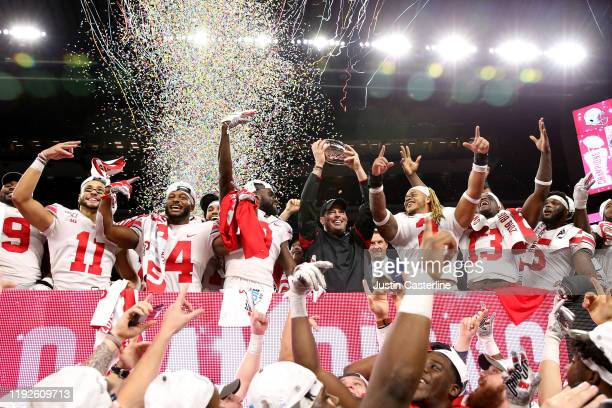 Head coach Ryan Day and the Ohio State Buckeyes celebrate after winning the Big Ten Championship against the Wisconsin Badgers at Lucas Oil Stadium...