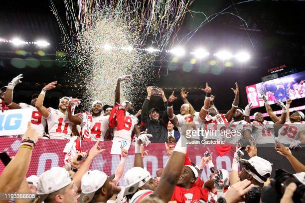 Head coach Ryan Day and the Ohio State Buckeyes celebrates after winning the Big Ten Championship against the Wisconsin Badgers at Lucas Oil Stadium...