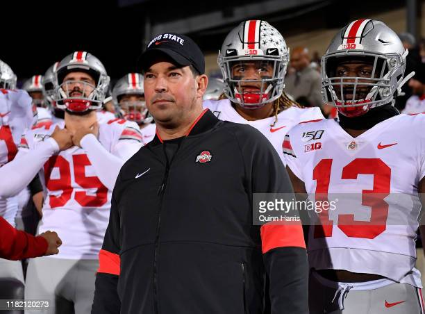 Head coach Ryan Day of the Ohio State Buckeyes and his players prepare to take the field before the game against the Northwestern Wildcats at Ryan...