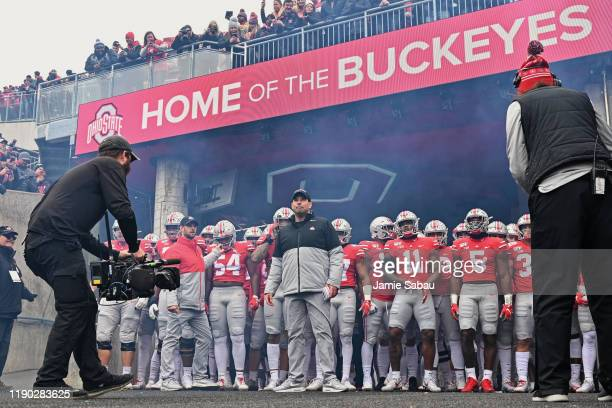 Head Coach Ryan Day of the Ohio State Buckeyes and his team prepare to take the field before a game against the Penn State Nittany Lions at Ohio...