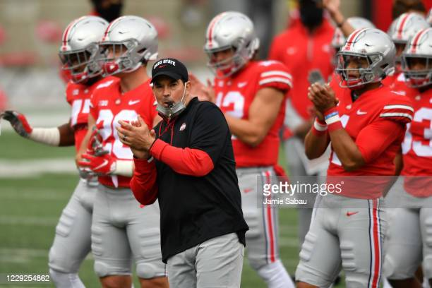 Head Coach Ryan Day of the Ohio State Buckeyes and his team warm up before their game against the Nebraska Cornhuskers at Ohio Stadium on October 24,...