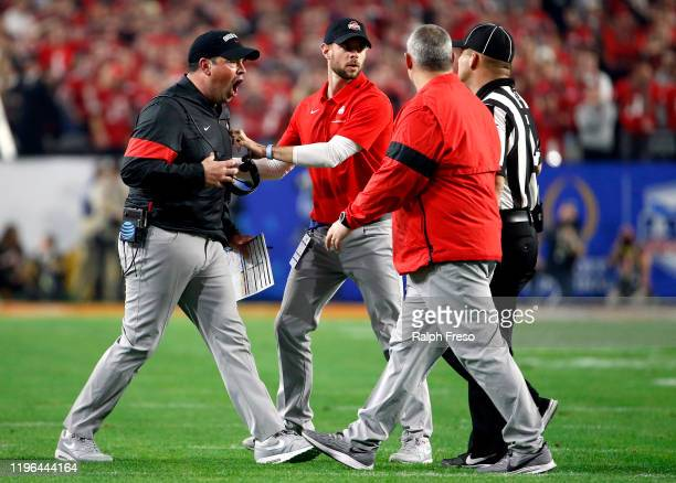 Head coach Ryan Day of the Ohio State Buckeyes argues the call with the referee against the Clemson Tigers during the College Football Playoff...