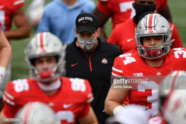 Head Coach Ryan Day of the Ohio State Buckeyes heads to the locker room at halftime with his team during a game against the Nebraska Cornhuskers at...