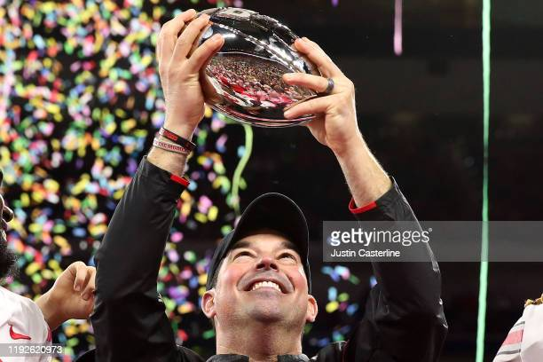 Head coach Ryan Day of the Ohio State Buckeyes holds up the Big Ten Championship trophy after a win over the Wisconsin Badgers at Lucas Oil Stadium...